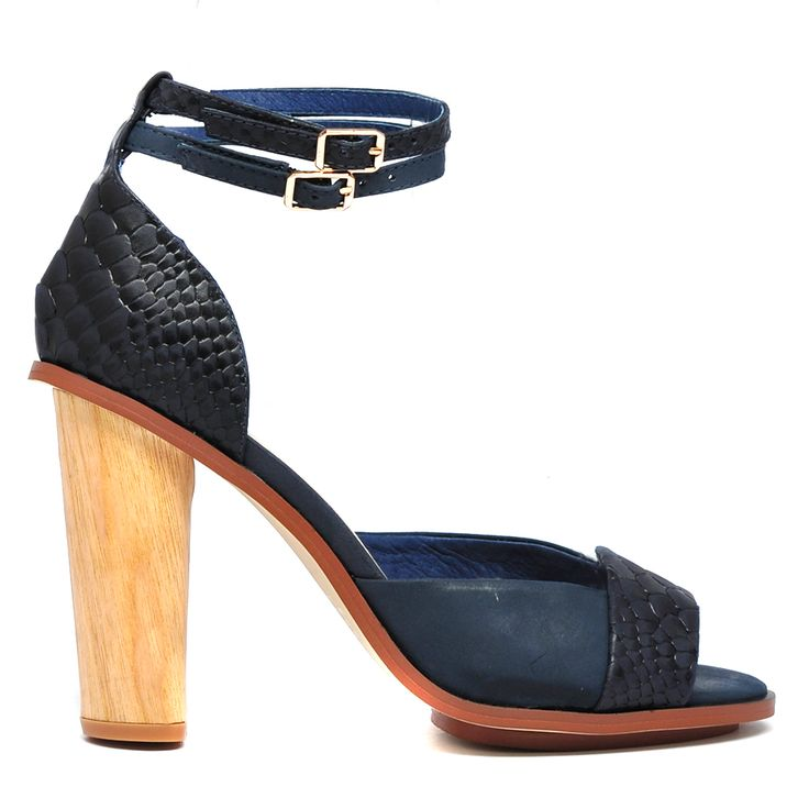 NAUTIC | Mollini - Fashion Footwear  Add a point of difference to your look with these snake printed leather heeled sandals. Featuring two fine ankle straps with adjustable buckles and a 10cm block heel. Pair yours with anything from a dress to skinny jeans. Leather upper, leather lining and man made sole.