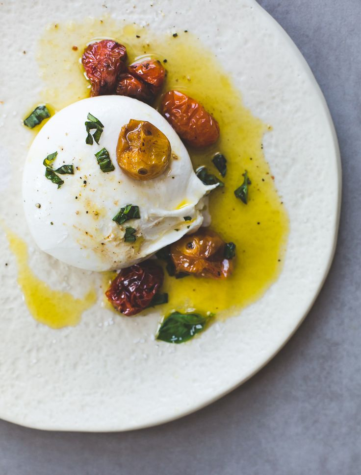 Soft & creamy burrata cheese topped with slow roasted cherry tomatoes, olive oil, & basil, an incredible summer appetizer. Can use buffalo mozzarella.
