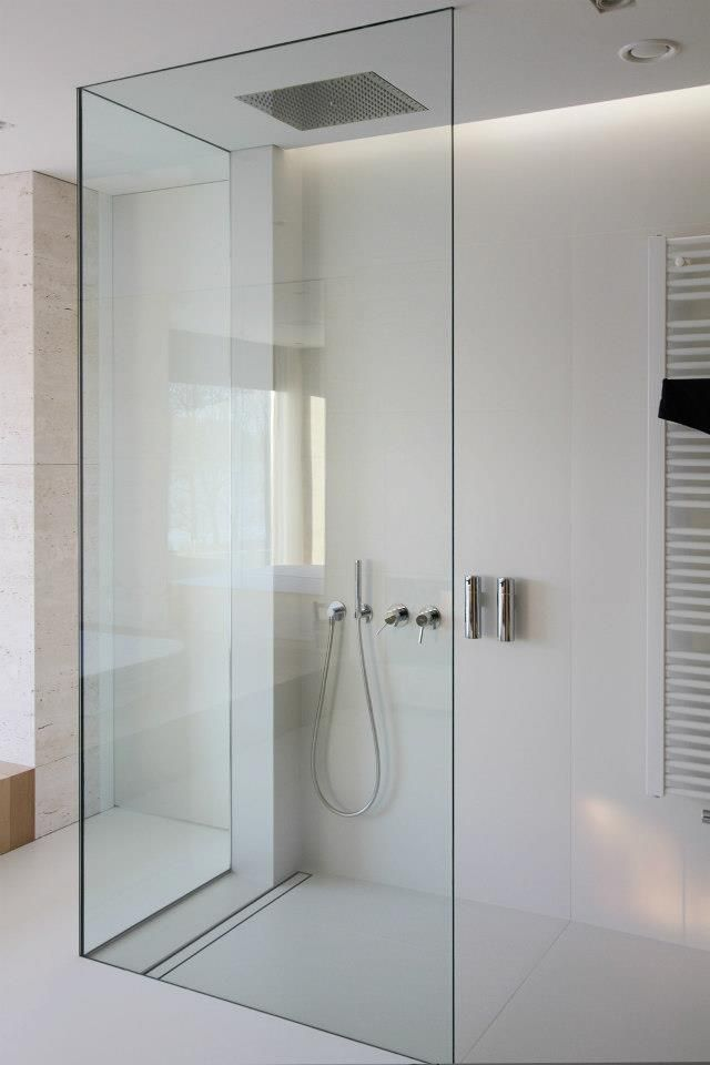Clean and minimal bathroom designed by Katarzyna Kraszewska. Love the hardware free glass shower enclosure. DRAIN!!
