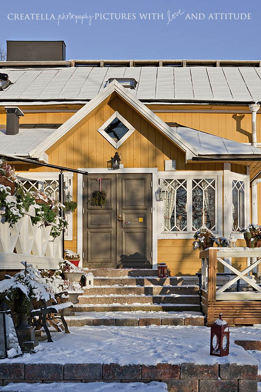Yellow wooden house in winter