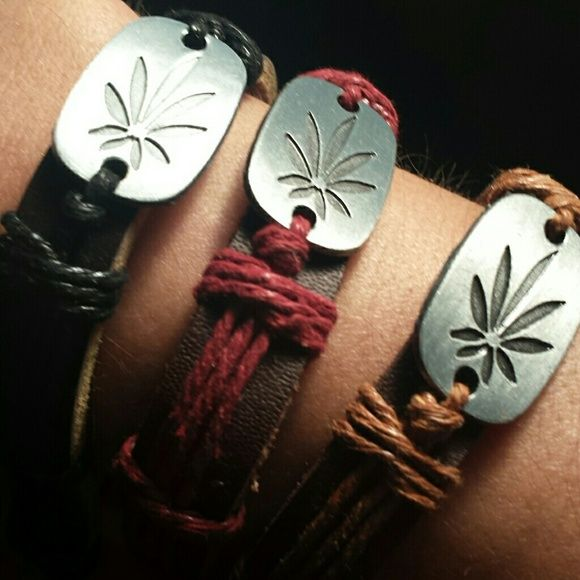 Such a pretty marijuana leaf. ...bracelets 3 color combinations, dark brown leather with darkest brown leather decor with silver marajuana leaf pendant.  Lighter brown with tan, and lighter brown with pink.  Mix n match, stack, fun Bo ho look. Adjustable and easy on and off... Don't purchase this just tell me the color or colors and ilk set up your listing, I have about 6 left!!! Jewelry