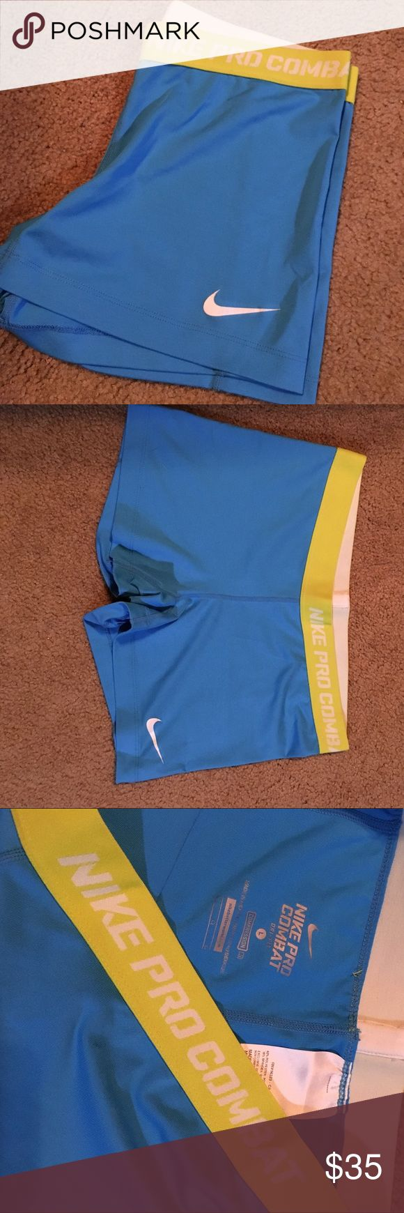 NIKE Compression Shorts - Women's Women's Blue and Neon Yellow Dry-Fit NIKE PRO COMBAT Compression Shorts. Size Large. Worn twice - still in great condition! Nike Shorts
