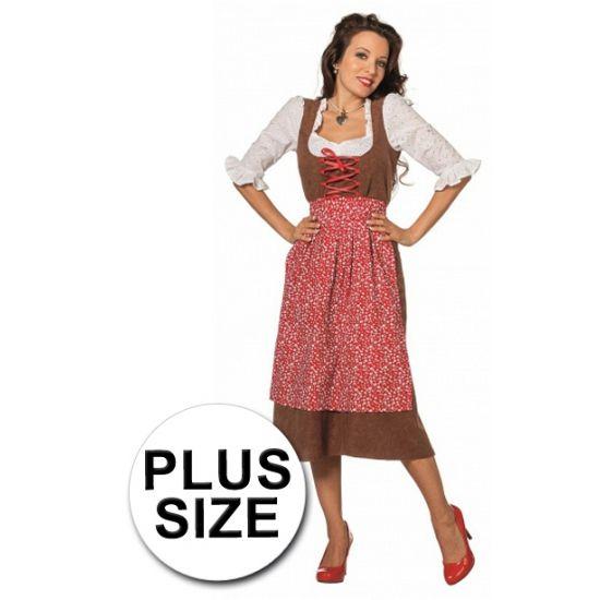 Grote maat lange tiroler jurk voor vrouwen. De basis van de jurk is een bruine stof, hier over heen komt een rood gebloemde schort. Aan de lange tiroler jurk zitten witte mouwtjes.