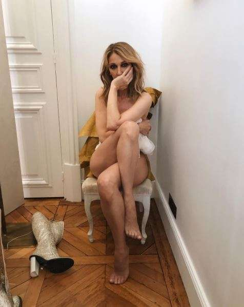 "Celine Dion Poses Naked In A New Photo Shoot     Celine Dion is currently making headlines with her latest photo session for Vogue Magazine.  Vogue shared this photo of the 49-year-old superstar in a candid clothing-free moment between  fashion shows in Paris France on Monday July 3 2017.  The singer is pictured sitting on a chair naked with her legs strategically twisted in front of her.  They wrote alongside the very candid shot ""Here's a little-naked fact to ponder while Celine Dion…"