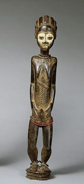 Female Diviner's Figure Date: 19th–mid-20th century Geography: Côte d'Ivoire, central Côte d'Ivoire Culture: Baule peoples Medium: Wood, pigment, beads, iron