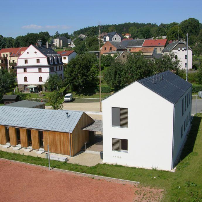 Ortsteilzentrum in Rechteck-Doppeldeckung von Rathscheck Schiefer
