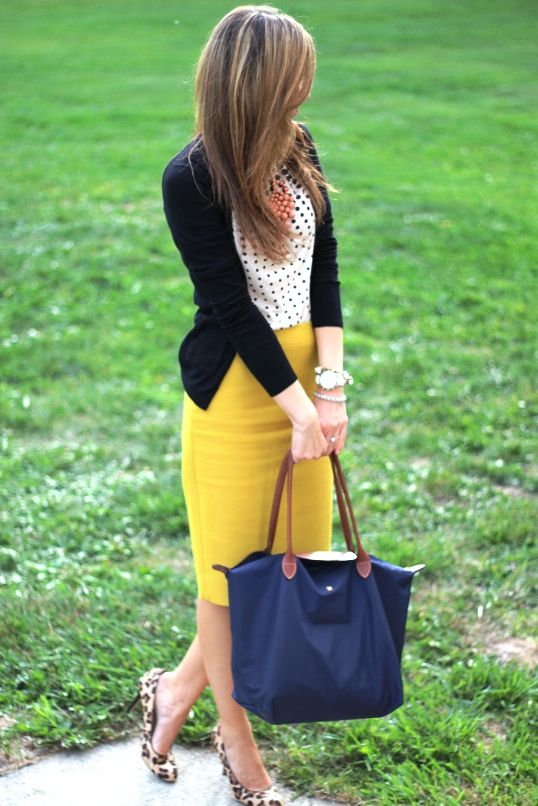black sweater ove a white polka dotted shirt +bright yellow skirts +leopard print sandals and a navy blue hand bag