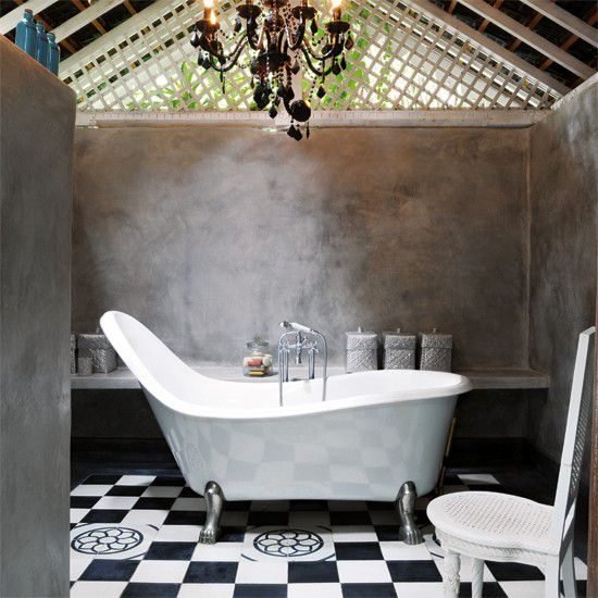 High back claw foot tub. Love the tile & black chandelier.
