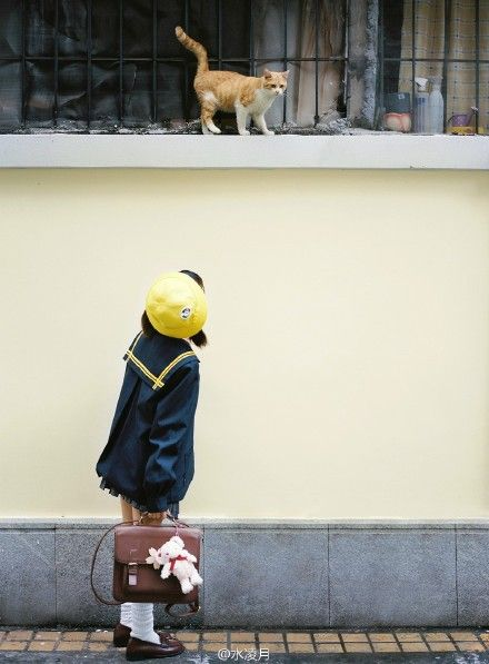 School girl and cat in Japan