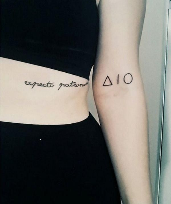 Never seen the Deathly Hallows tattoos in pieces like that, very cool! - collarbone?