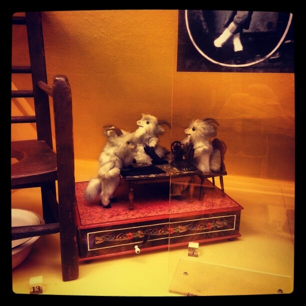 Musical box with three tailoring goats. Worcestershire County Museum, Hartlebury Castle.