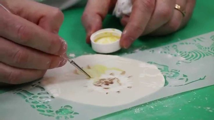 Painting Stencils onto Cookies In this video Chef Alan Tetreault, of Global Sugar Art, teaches viewers how to paint designs onto fondant covered cookies using stencils and his new line of Edible Hybrid Luster Dusts. Chef Alan's gorgeous new line of luster dusts dissolve easily in water or lemon extract to make painting stencil designs onto cookies a breeze with beautifully professional results.   https://www.youtube.com/watch?v=UGgp0LSkT2Y