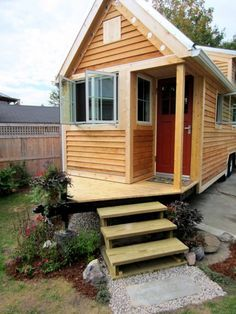 Tiny House with Porch over Hitch of Trailer This is the solution to an idea that has been floating around in the back of my mind for a while. Put a support at the apex of the triangle and one opposite the existing column and one could have a nice little covered porch next to the entry :)