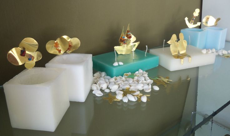 Candles with a variety of bronze creations and gemstones