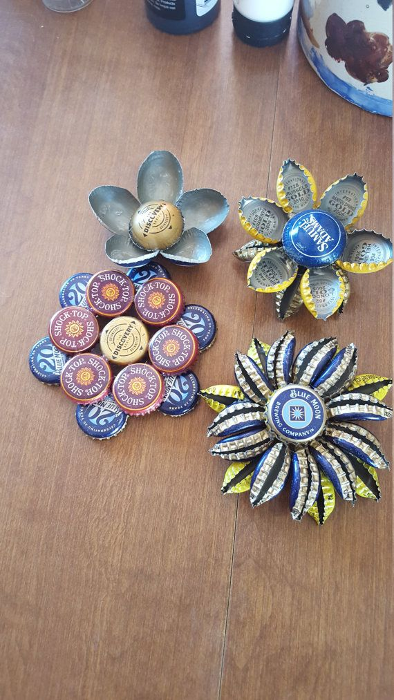 Custom made to order bottle cap garden flower. Its a cute piece of garden or yard art that will add a unique look to your garden or outdoor space! If youd like non-alcoholic bottle caps the price will increase a little due to buying different supplies. Im happy to oblige all requests as long as I can find caps in the colors youd like for your flowers. These flowers come sealed to help protect them from the elements & the sun. The more flowers you buy, the bigger the discount! 2 for $40, 3…