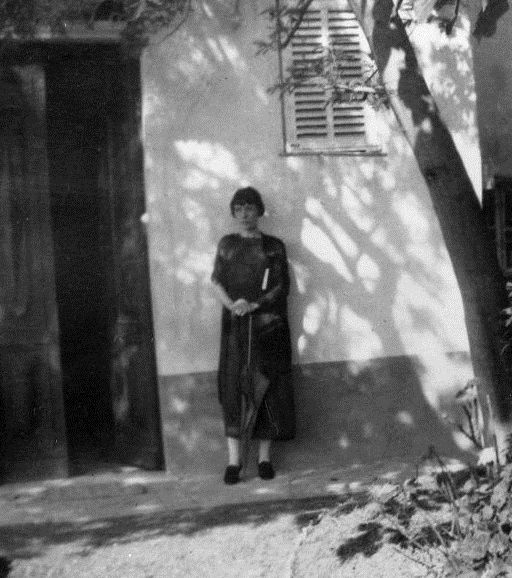 katherine-mansfield: Katherine Mansfield standing in the garden at the Villa Isola Bella, Menton, France(1920)