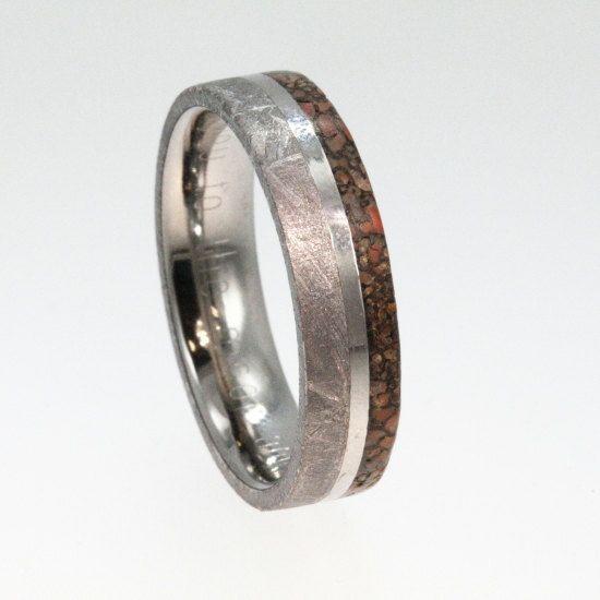 holy crap. Meteorite Ring / Dinosaur Bone Ring / Gibeon Meteorite and Dinosaur Bone inlaid on Titanium with Titanium pinstripe. $776.00, via Etsy.