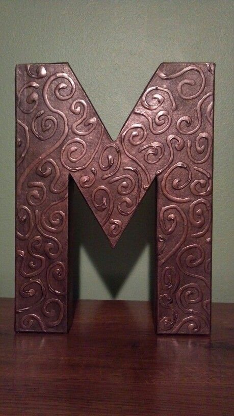 Cardboard letter from craft store, Elmer's glue and metallic spray paint