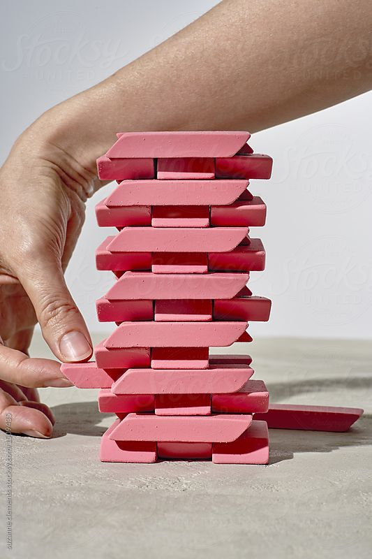 Erasure Jenga Topple Game  by suzanne clements for Stocksy United