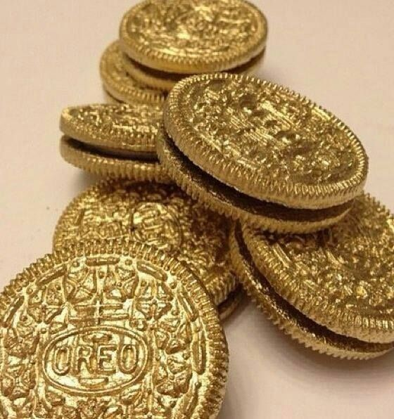 Oreos.....painted with edible spray paint.  New Years Eve, gold 'coins' for kids pirate party, an Academy Awards party, or St. Patty's pot of gold. Endless possibilities.