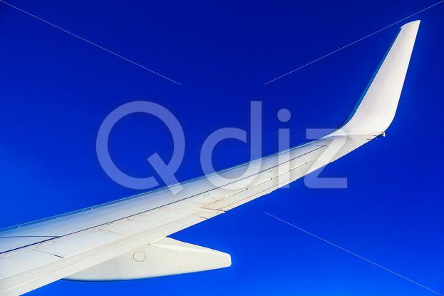 Qdiz Stock Images Plane Wing on Sky Background