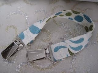 Bib Clip...would be great to add to burp cloths to make them usable after baby has stopped spitting up