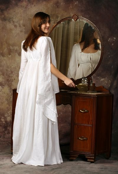 """""""A handkerchief weight 100% linen romantic nightgown. Features a double layered empire bodice, bell shaped sleeves with Victorian shell buttons (shown unbuttoned), and full circle skirt."""""""