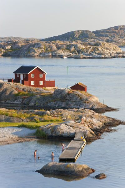 Bathing in sea, Skarhamn on island of Tjorn, Bohuslan, on West Coast of Sweden © Peter Adams