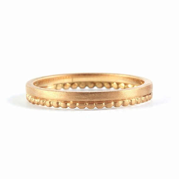 This simple dainty beauty 18k wedding ring band comes with a twist, the dots give the ring a crown look and the band shows its glory! Comes in a matte