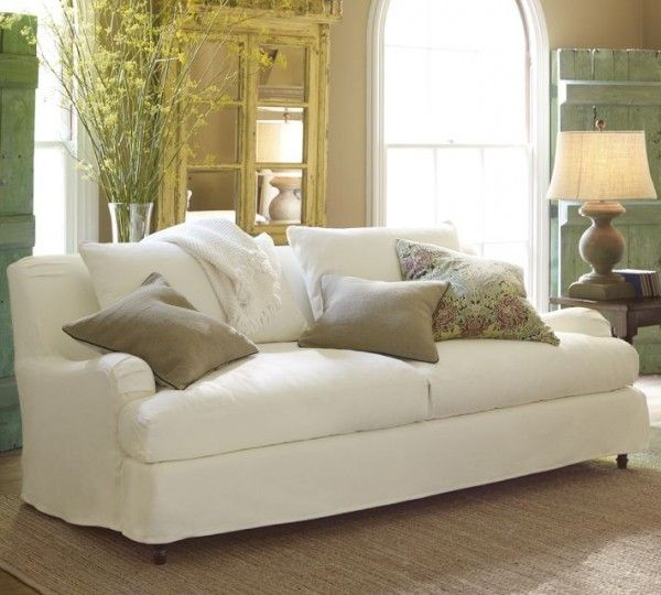 Decorating on a budget! A traditional English roll arm couch with slipcovers from Pottery Barn. #home #decorating #decor