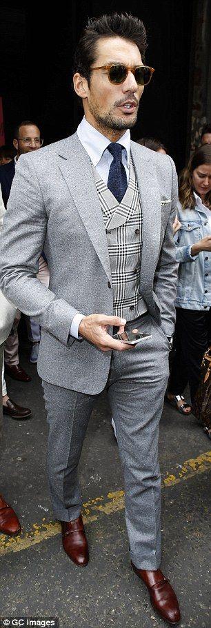 Dapper Lewis Hamilton rocks rose-print sports jacket and kooky shades #dailymail