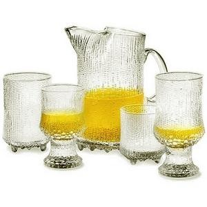 Ultima Thule Glassware By Tapio Wirkkala For Iittala. Developed in 1968, the pattern is created when the molten glass burns into the surface of the wooden moulds. *** http://en.wikipedia.org/wiki/Tapio_Wirkkala