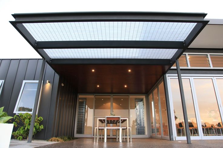 ALFRESCO - indoor outdoor living to north elevation exposed structural steel sun awning. Passive solar design with end folding and stacking doors. Exposed aggregate concrete to TERRACE.