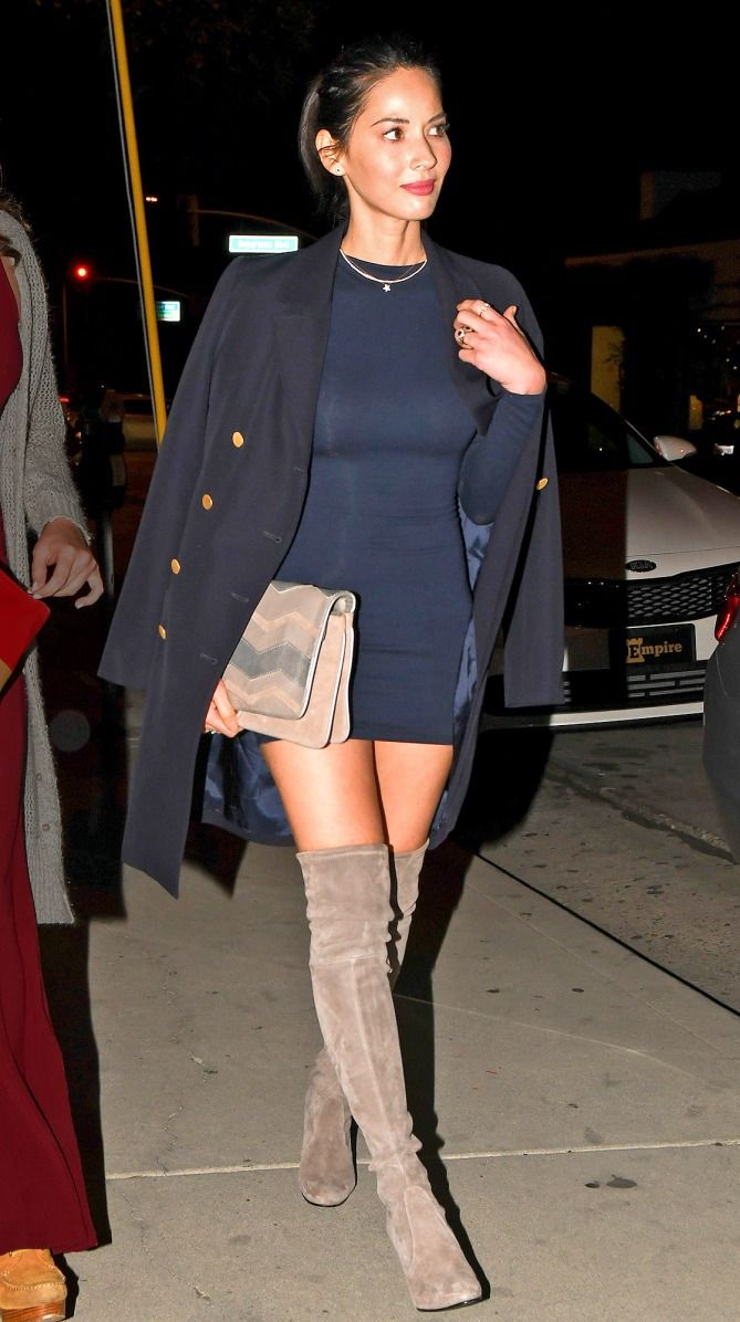Olivia Munn in a black minidress, black coat and over-the-knee tan boots - click through for more celebrity spring outfit ideas
