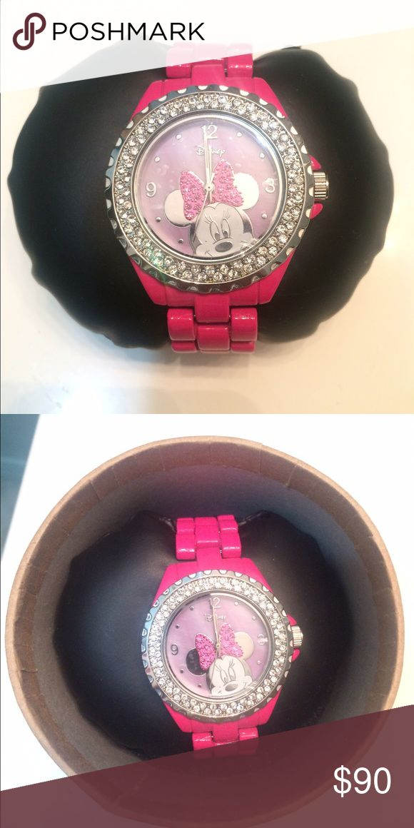 HOT PINK MINNIE MOUSE WATCH pink Minnie Mouse watch with silver crystals. never worn. clock doesn't work/can possibly be fixed. still looks cute. In original box. Disney Accessories Watches