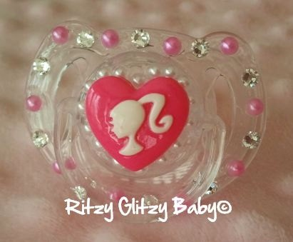 Barbie Girl Bling Pacifier $20....cute but would never pay $20 for something that WILL disappear! There is such thing as a paci monster!