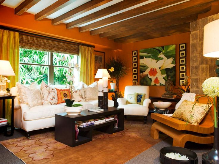 The Rich Orange Color, Tropical Decor And Exposed Beams Make This Living  Room Feel Like A Resort.