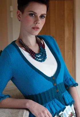 Knit cardigan by artesano yarns.