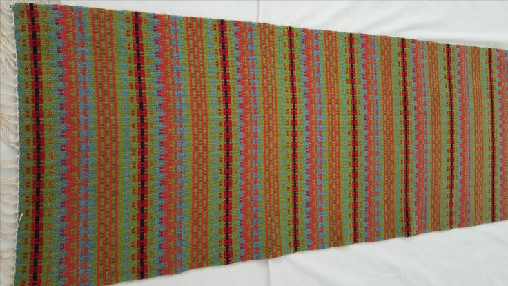 1089 - handwoven cotton and rug wool runner/hanging.  Traditional Norwegian pattern - Crooked Path - 'Krokbradg' in lime and rust.  130 x 50 cm