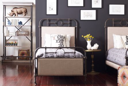 From Left to Right: Braxton bookcase, Berkley metal twin bed, Marlow Victorian pedestal table, cube ottoman