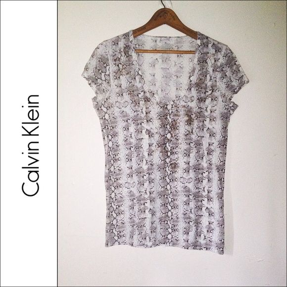 CALVIN KLEIN | Snake Print Brown Beige Tee T Shirt ➻ Great condition. ➻ Scoop neck. ➻ Short sleeves. ➻ Features vertical snake print throughout.  ➻ No trades. Please refrain from asking. ➻ Negotiations will take place through the 'Offer' button ONLY. Sale prices are firm. Calvin Klein Tops Tees - Short Sleeve
