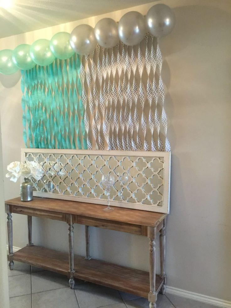 Best 25 budget baby shower ideas on pinterest baby shower ideas mint and grey baby shower easy streamer waterfall over gift table negle Gallery