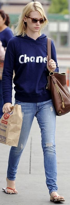 Hooded sweatshirt and ripped blue skinny jeans