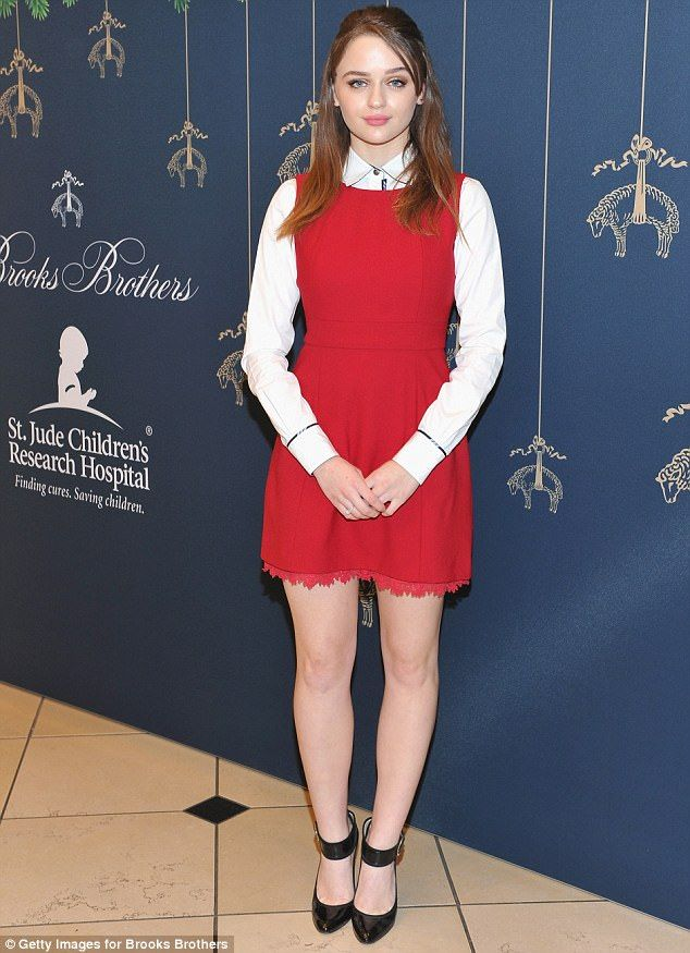 Sugar and spice!Joey King was darling in a red dress on top of a white button-up while pinning her hair back into a neat half-pony