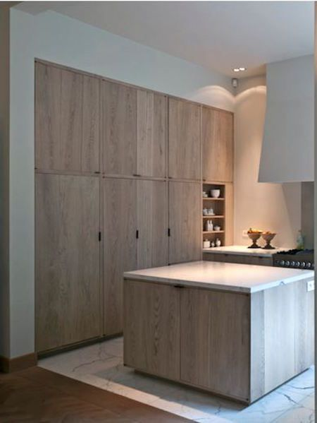 Another view of the kitchen shows the subtle effect of the finish on a big, slab-front pantry-cabinet wall which gives the effect of the natural wood look ...