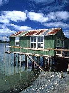 Old tide-side building being done up for it's new life as The Boatshed Cafe in Rawene.