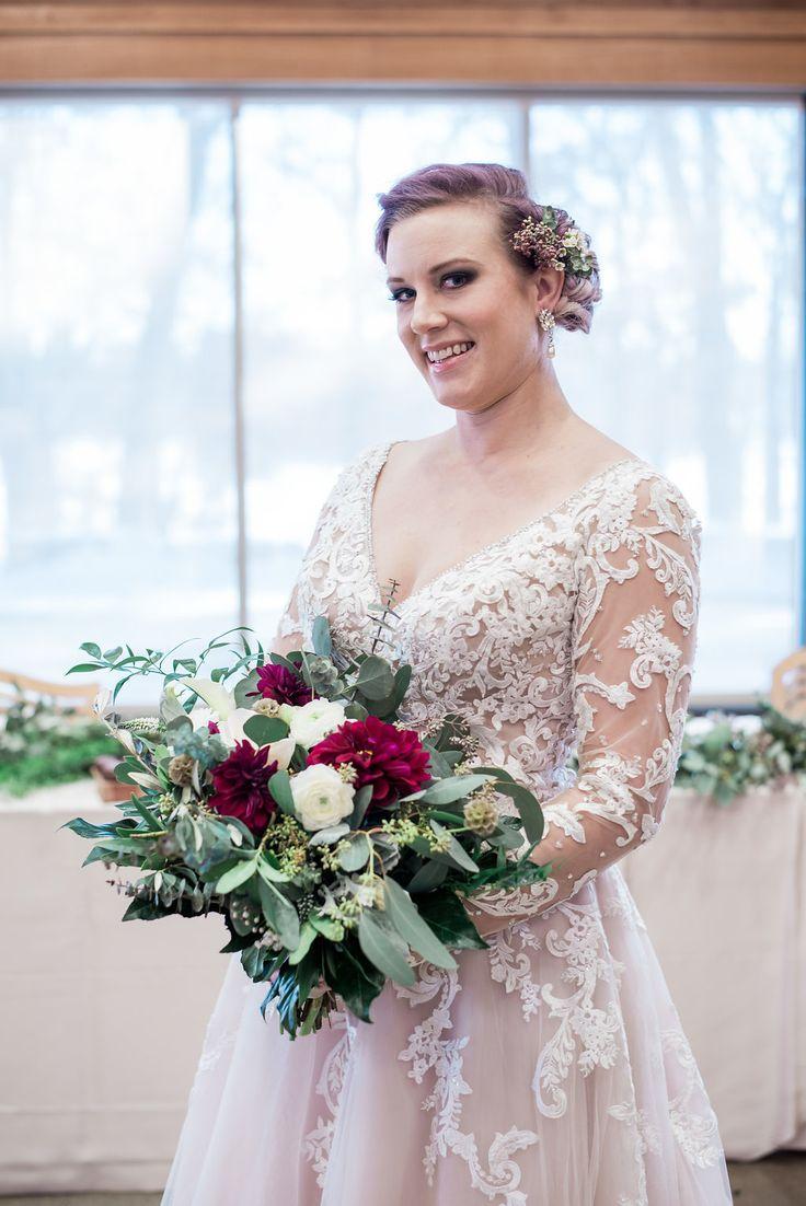 Winter bride inspiration. Floral designed by Minneapolis wedding florist Artemisia Studios. Photo by Iris Studios Photography (https://www.irisstudiosphoto.com/) #bride #winterbride #mnbride #winterwedding #bridalstyle #bridallook #bridalbouquet #burgundy #burgundywedding #flowers #floral #weddingflowers #winterflowers #minneapolisweddingflorist #minnesotaweddingflorist #artemisiastudios