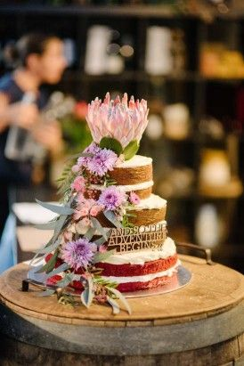 Naked wedding cake with australian native flowers
