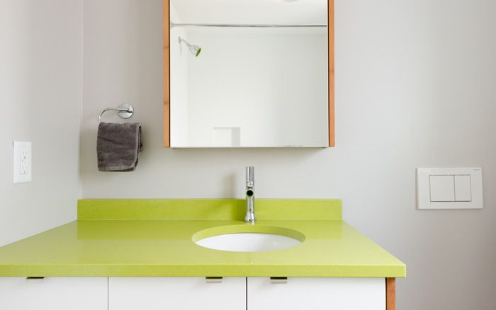 east 32- an apple green countertop in the boys bathroom adds a splash of colour #mangodesignco