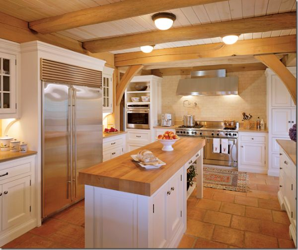 warm kitchen with lovely beams and tile floor #kitchen